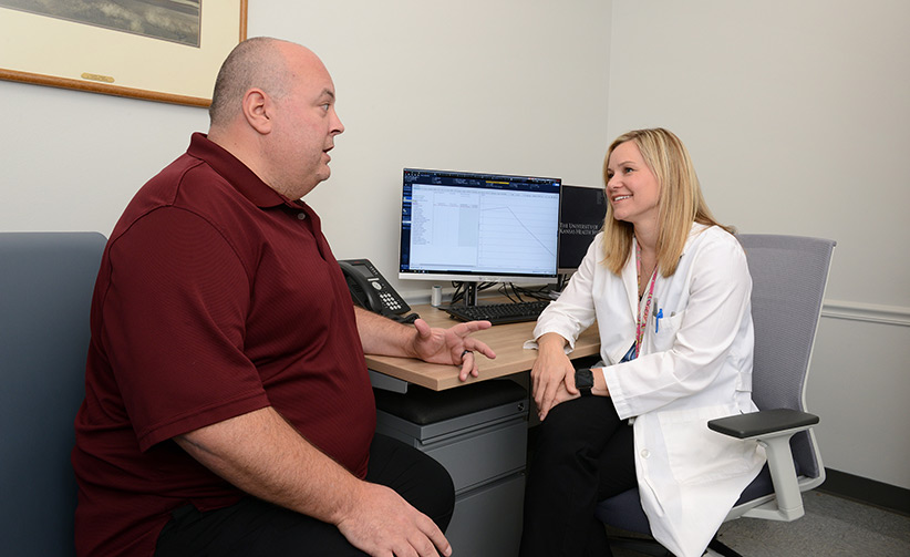 James Pryor talks with Dr. Stolte in her office